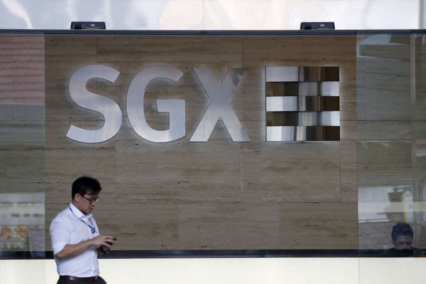 A man leaves the SGX Singapore Exchange building in Singapore's central business district on Jan 7, 2016.