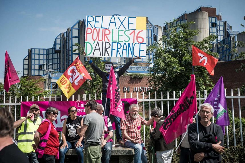 Air France workers of the CGT union (General Confederation of Work) gather next to the Bobigny courthouse, in Bobigny, France, on May 27, 2016.