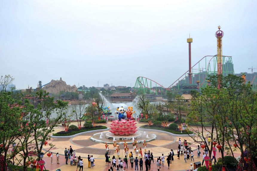 People visit the newly open theme park Wanda City in Nanchang, China, on May 28, 2016.