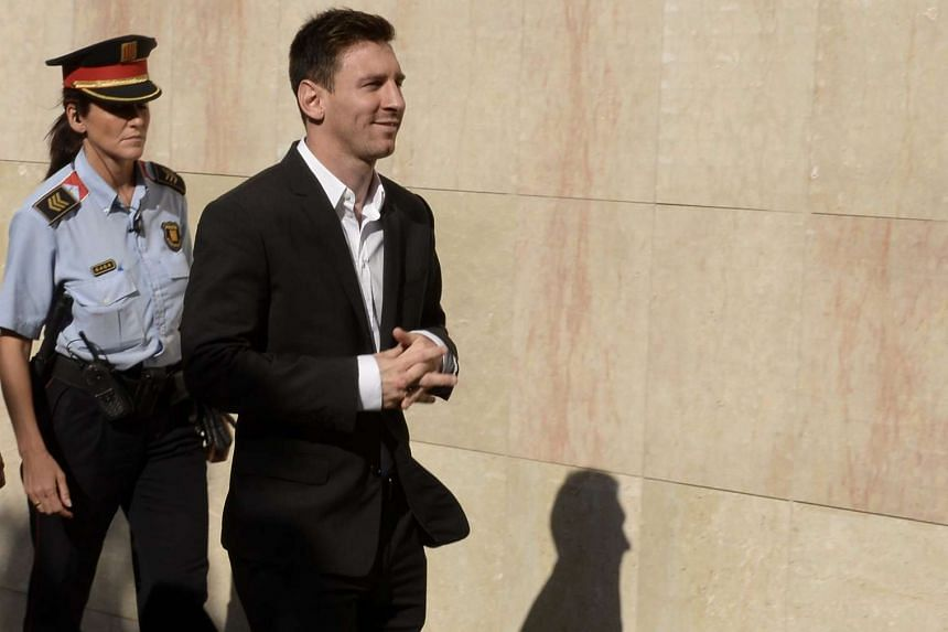 Lionel Messi arriving at the courthouse in Gava, near Barcelona, on Sept 27, 2013 to face judges on tax evasion charges.