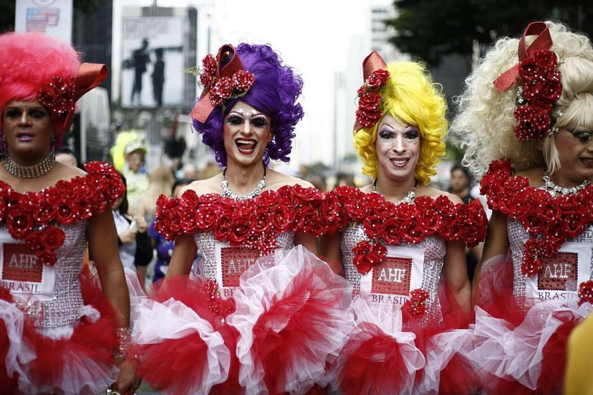 "Revelers take part in the 20th Gay Pride Parade, whose theme is ""Gender identity law, NOW! Everyone together against transphobia!"", in Sao Paulo, Brazil on May 29, 2016."