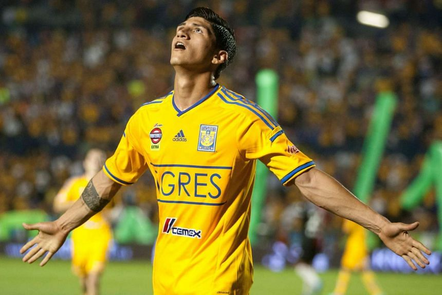 Tigre's Alan Pulido celebrating after scoring against Atlas during their 2014 Mexican Clausura tournament football match in Monterrey, Mexico, on April 26,2014.
