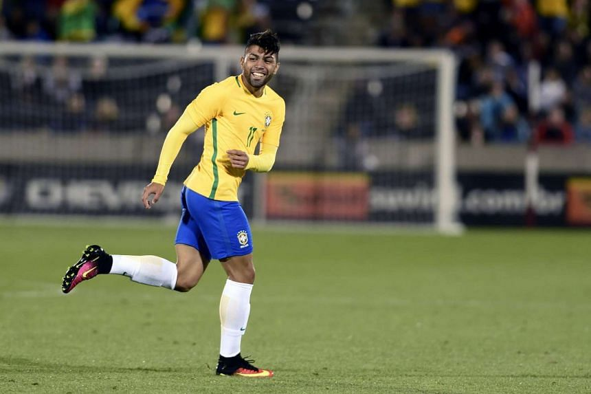 Gabriel Barbosa smiles after scoring a goal against Panama during the friendly football match between Brazil and Panama on May 29, 2016.