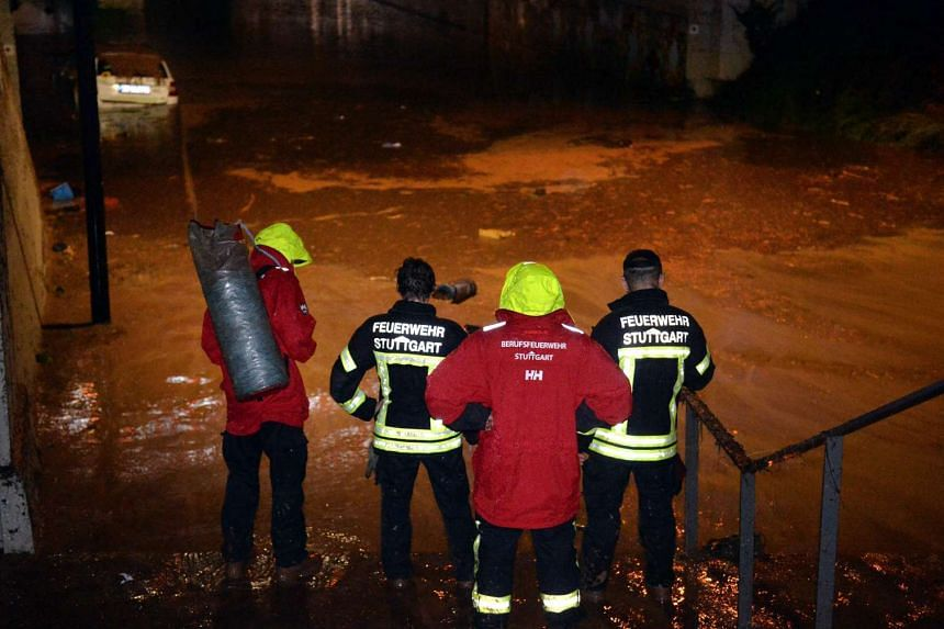 Firefighters at work following torrential downpours in Schwaebisch Gmuend, Germany, on May 29, 2016.