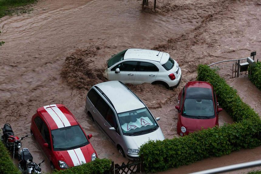 Cars are seen in a flooded street in Schwäbisch Gmünd, Baden-Württemberg, southern Germany after heavy rains hit the country on May 29, 2016.