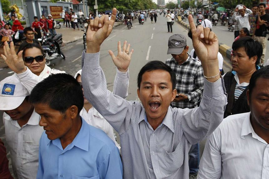 Supporters of the opposition Cambodia National Rescue Party (CNRP), shout slogans during a rally in Phnom Penh, Cambodia, on May 30, 2016.
