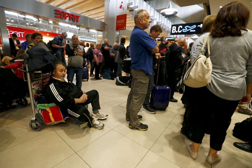 Delayed passengers wait following a security alert at Cologne airport, in Cologne, Germany, on May 30, 2016.