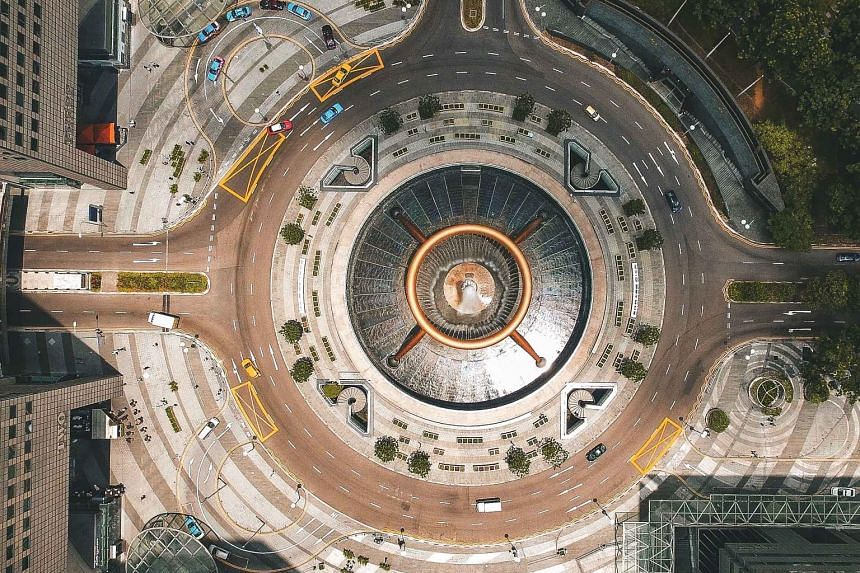 """A shot of the Suntec City roundabout by photographer Joel Chia, who uses a drone camera to capture unusual views of Singapore. In a Facebook post yesterday, PM Lee said Mr Chia """"shows us Singapore from a different perspective that many of us rarely c"""
