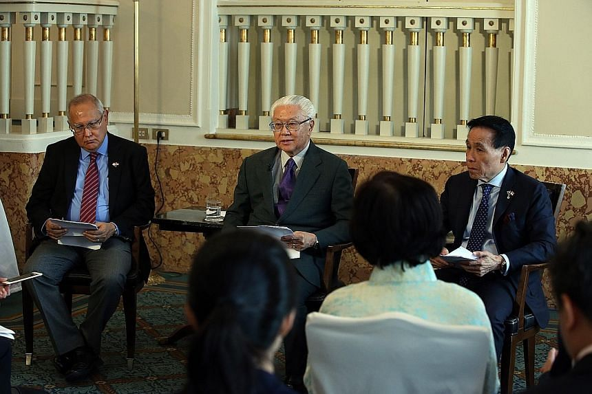 President Tan speaking to the media at the end of his eight-day state visit to Italy and the Holy See yesterday. With him were Mr Barry Desker (far left), Non-Resident Ambassador of Singapore to the Holy See, and Mr Ow Chio Kiat (at right), Non-Resid