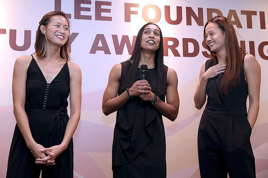 (From left) Chen Huifen, 31, Premila Hirubalan, 33, and Micky Lin, 30, being inducted into the Netball Hall of Fame at the Netball Singapore Awards Night last November.