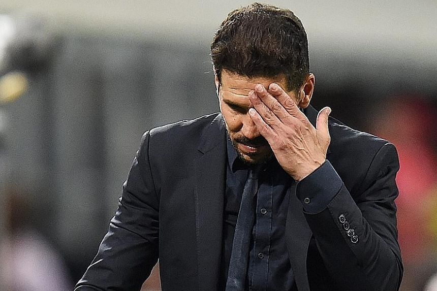 Real manager Zinedine Zidane and Atletico boss Diego Simeone (above) show contrasting emotions after the final whistle at the San Siro in Milan.