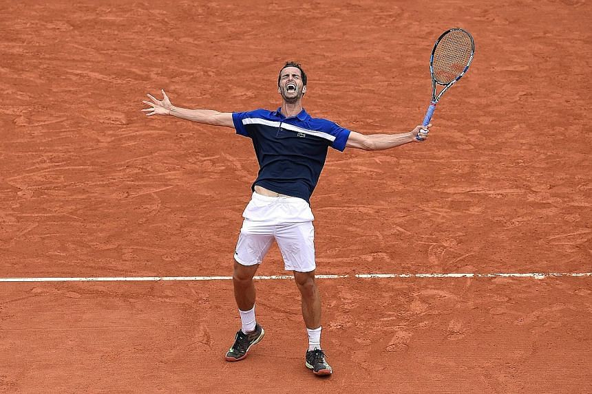 World No. 55 Albert Ramos-Vinolas celebrating his victory over eighth seed Milos Raonic. The Spaniard arrived in Paris with just four wins in Grand Slam matches.