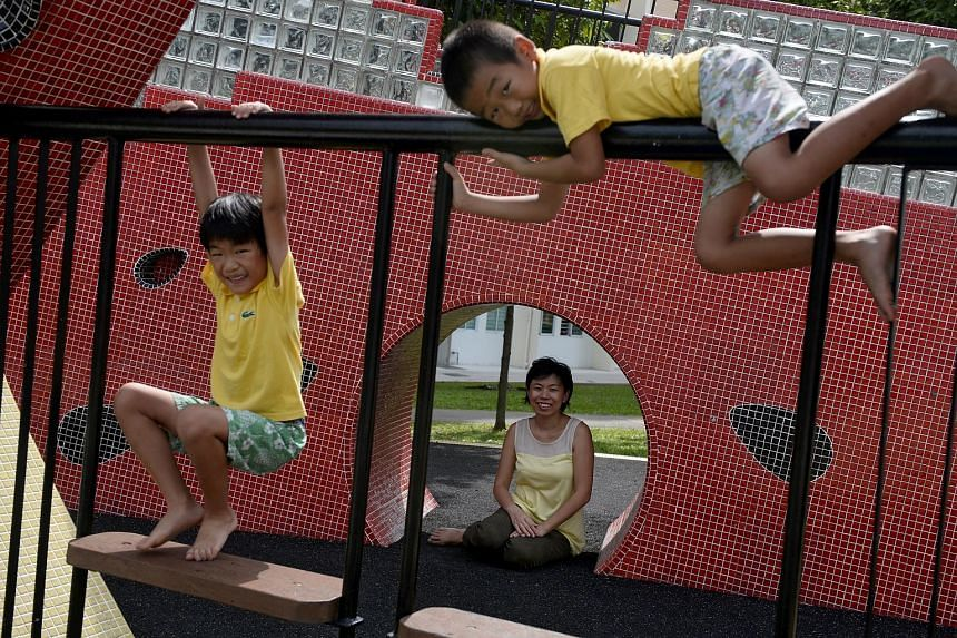 Mrs Sarah Lee-Wong with her sons Elisha (left) and Ezekiel at a watermelon mosaic playground in Tampines. The homeschoolers have been studying playgrounds as part of a project exploring play spaces.