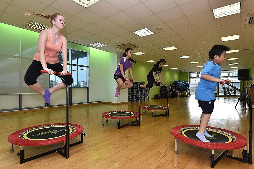 Participants trying out Boogie Bounce Xtreme. This aerobic workout on mini trampolines is among the new activities being offered by ActiveSG next month.