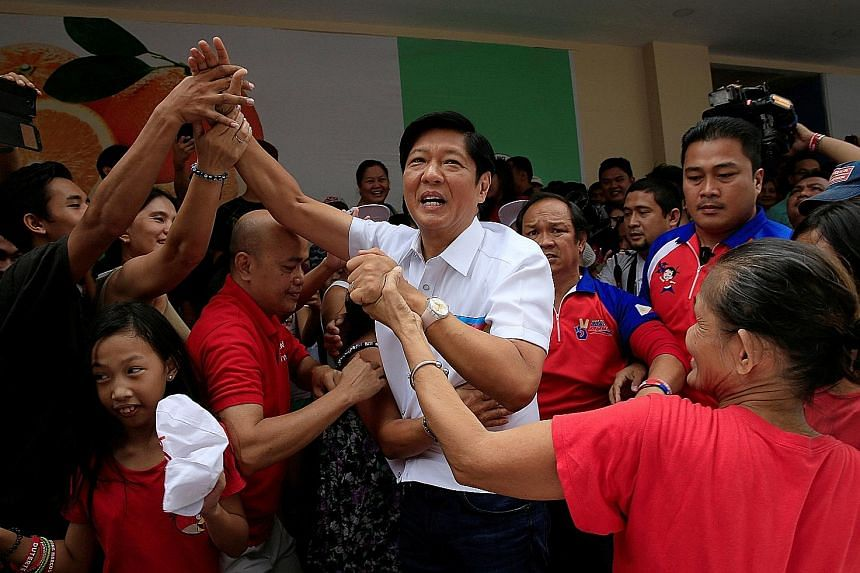 Mr Marcos with supporters at a campaign rally in Manila on May 7. He has been adept at channelling the good memories of his father and namesake, the dictator Ferdinand Marcos, while keeping his distance from the bad ones.