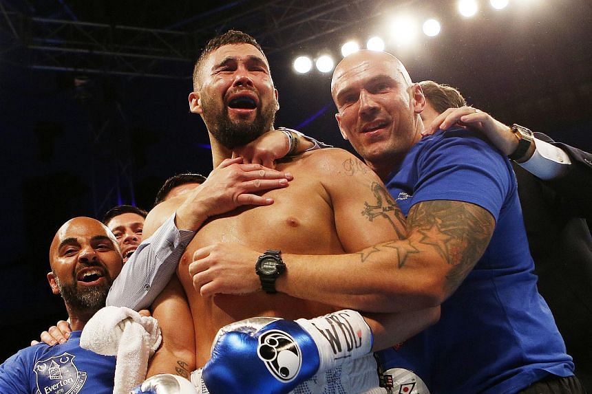 Tony Bellew celebrates winning the fight against Ilunga Makabu for the WBC Cruiserweight Title.