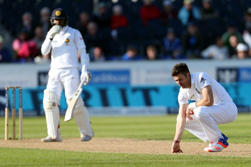 England's James Anderson (right) reacts on the third day of the second test cricket match between England and Sri Lanka at the Riverside in Chester Le Street.