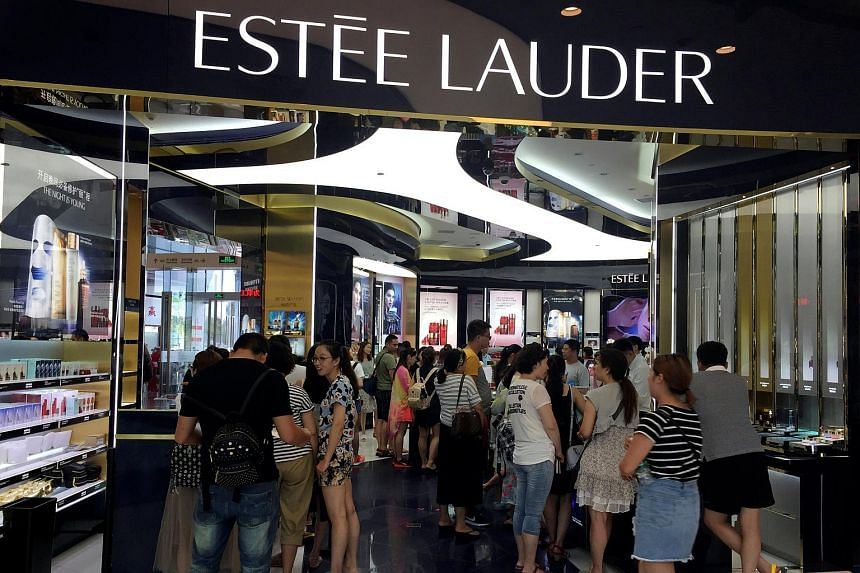 Chinese shoppers crowd a luxury store inside a mall in Sanya on Hainan Island.
