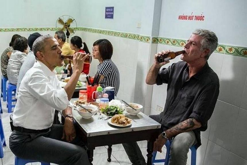 Mr Obama and Mr Bourdain drink their beers during a bun cha meal in a Hanoi restaurant.