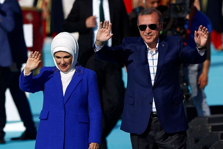 Turkish President Tayyip Erdogan, accompanied by his wife Emine Erdogan, greets supporters during a rally to mark the 563rd anniversary of the conquest of the city by Ottoman Turks.