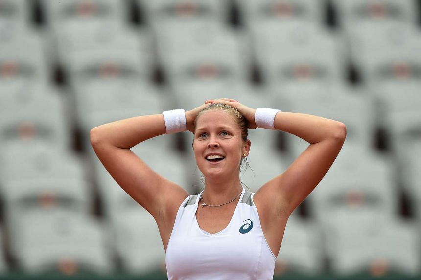 US player Shelby Rogers celebrates after beating Romania's Irina Begu at Roland Garros.