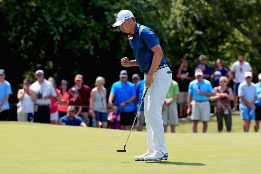 Jordan Spieth reacts after a putt during the Final Round of the DEAN & DELUCA Invitational at the Colonial Country Club in Texas on Sunday.