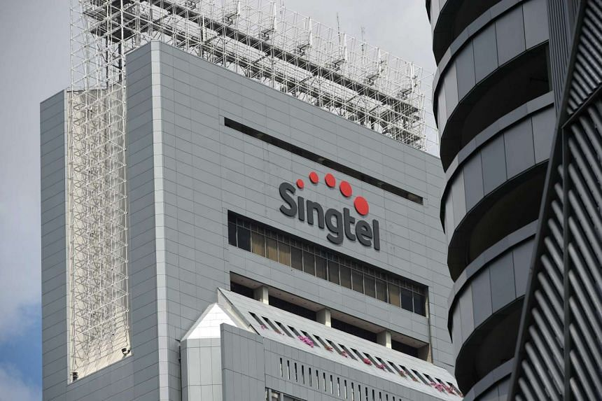 The Singtel logo is seen on its headquarter building in Singapore.