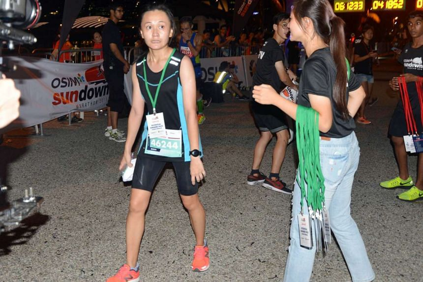 Local runner Sharon Tan (pink shoes) won the Osim Sundown Marathon women's 42km race after slashing her personal best by more than an hour. She recently joined a running club and learnt the importance of speed and strength training. She finished in