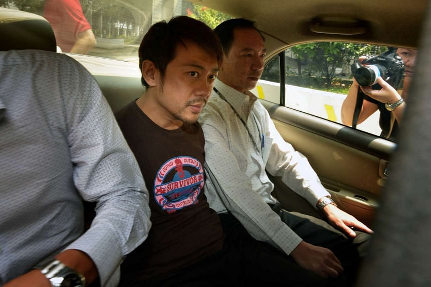 Yang Yin arriving at court in a police car on Nov 5, 2014.