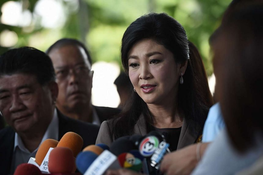 Deposed former Thai prime minister Yingluck Shinawatra speaks to the press as she arrives for a hearing at the Supreme Court in Bangkok, on April 22, 2016.