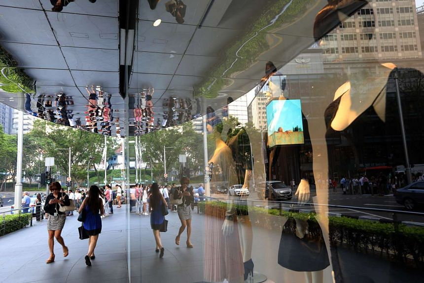 Shoppers walking along the shops at Orchard Road on March 10, 2014.