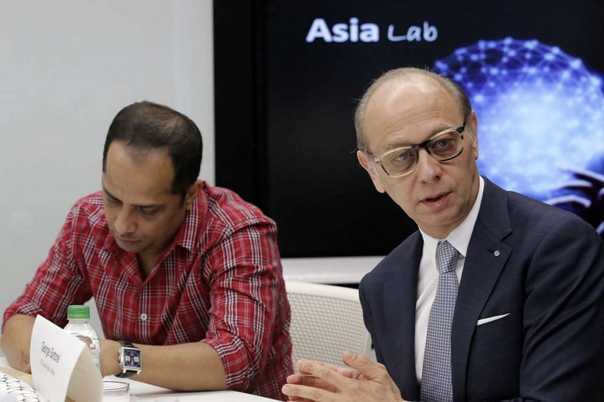 Mr Sopnendu Mohanty (left), MAS' chief fintech officer, and Mr George Sartorel, CEO of Allianz Asia Pacific, at a media roundtable on May 25, 2016.