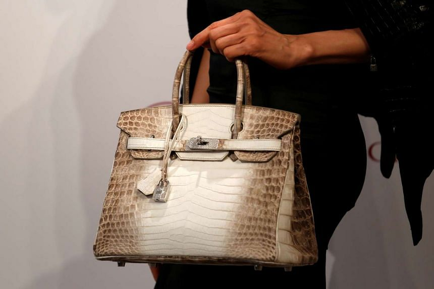 16eab93e133 A model carries a Hermes signature Birkin with Himalayan crocodile leather  during a preview in Hong