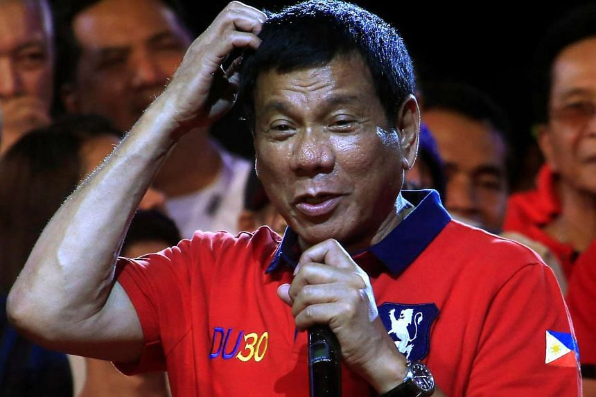 Davao city mayor Rodrigo Duterte addressing his supporters at a rally before the Philippines' national elections in May. Mr Duterte named his Cabinet on May 31, 2016 following his landslide election victory.