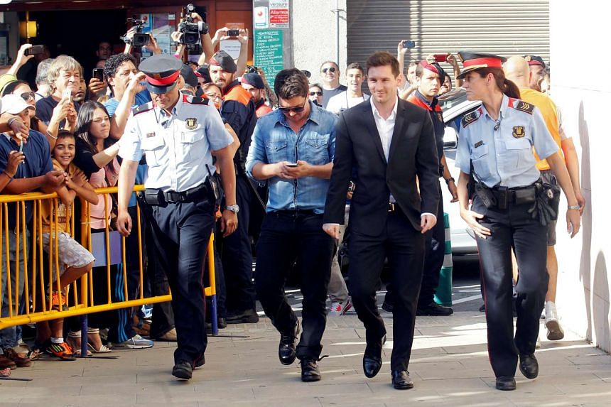 Barcelona's forward Lionel Messi (third from left) arrives at a court to answer charges of tax evasion in Gava, Spain, on Sept 27, 2013.