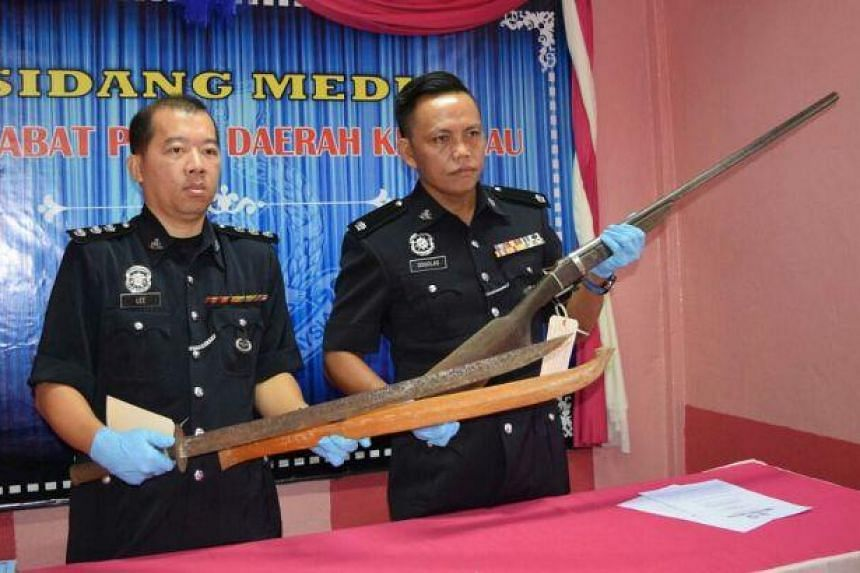 DSP Douglas (right) with the homemade gun used by the suspect.