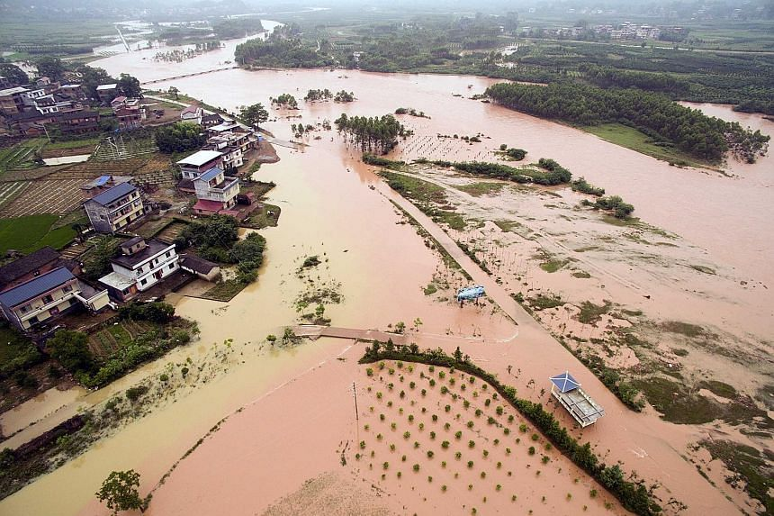 Chinese weather agencies have warned of more rain and even hail, after tens of thousands were displaced in large-scale floods.