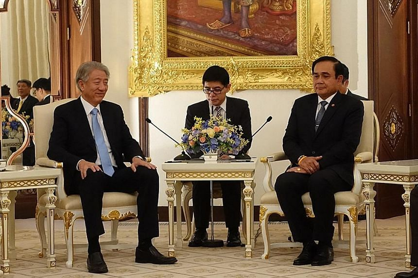 DPM Teo (left) met Thai PM Prayut and other ministers to discuss matters relating to security, cyber security and anti-terrorism on his two-day visit to the country.