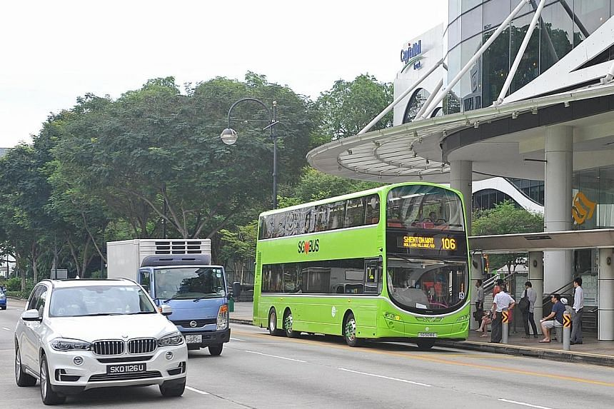 Tower Transit's bus service 106, decked out in its official colour, picking up passengers in Dhoby Ghaut. Some commuters did not realise the bus services had changed hands because many buses were not yet painted green.