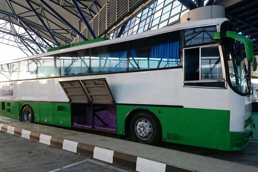 The Malaysia-registered bus that had hidden compartments containing the contraband items.