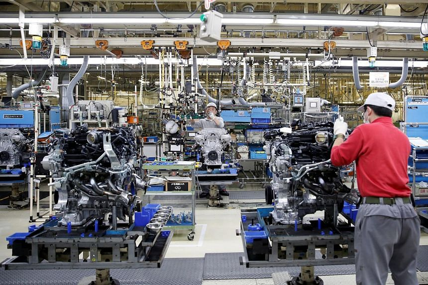 Employees work at a main assembly line at the Nissan Iwaki Plant in Iwaki city, Fukushima prefecture, Japan, April 5.