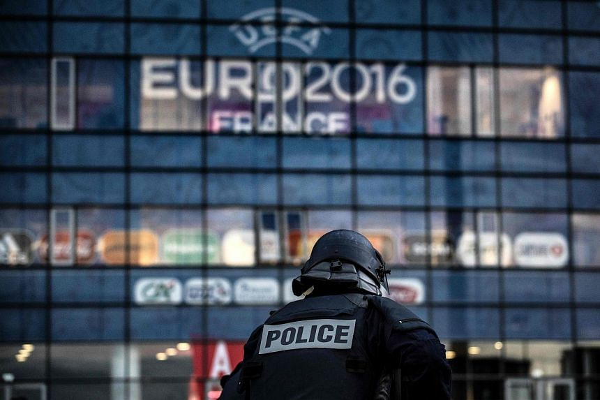Policemen take part in a mock suicide attack exercise as part of security measures for the upcoming Euro 2016 football championships.