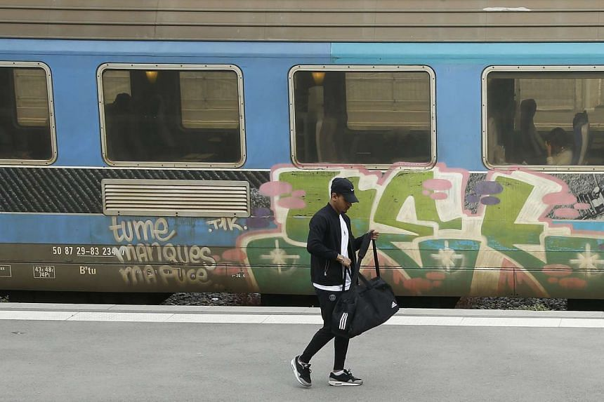 A railway passenger walks on empty platform during an SNCF French national railways strike in Paris, France on May 25. The protest takes place as part of wide-spread protests against the French government's labor reform project.