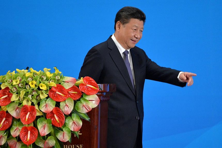 Chinese President Xi Jinping goes down the stage after a speech on the opening ceremony of CICA.