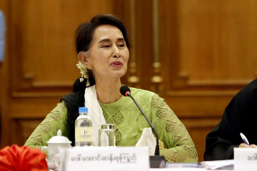 Aung San Suu Kyi speaks to members of the Union Peace Dialogue Joint Committee during a meeting in Naypyitaw, Myanmar, on May 27, 2016.