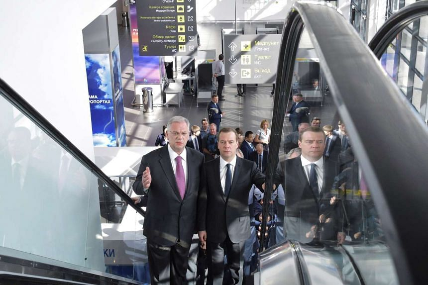 Russian Prime Minister Dmitry Medvedev (right) visits the newly constructed Zhukovsky airport near Moscow, Russia, on May 30, 2016.