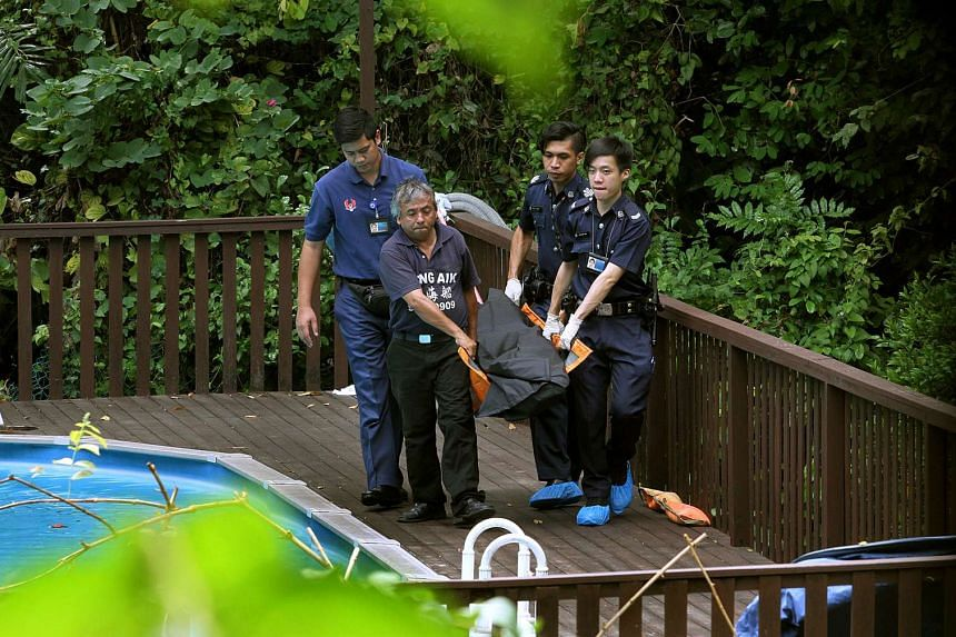 The body of Ms Nancy Gan being taken away from the swimming pool of her Victoria Park Road bungalow at Bukit Timah on March 19, 2014.