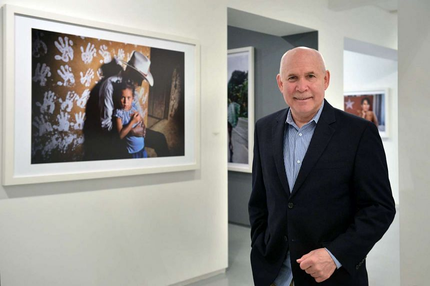 American photographer Steve McCurry at his solo show, titled Steve McCurry: The Iconic Photographs, in January 2016 in Singapore.