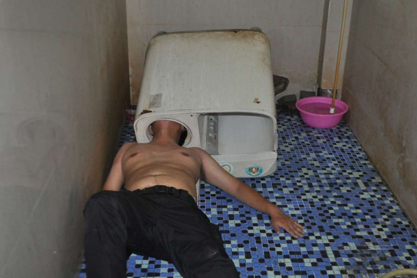 A man in China had to be rescued by six firefighters after he got his head stuck in a washing machine.