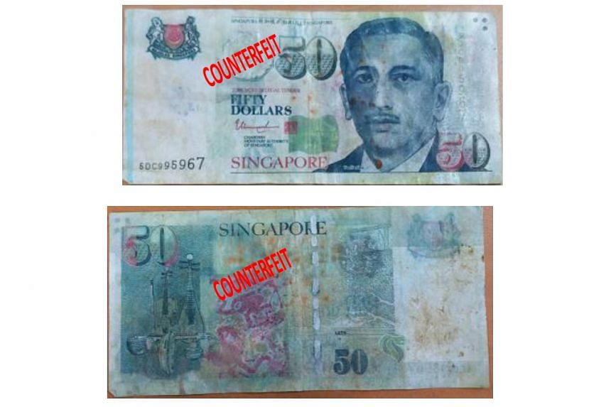 The $50 counterfeit notes lack security features such as a watermark and a security-thread found on genuine notes.